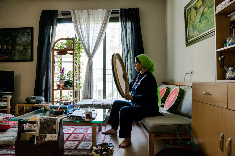 """Hannah practicing the """"Daf"""" (traditional hand-drum) at her home in Tehran. Hannah belongs to a famous family of musicans in Iran called """"The Kamkars""""."""